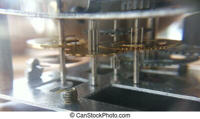 vintage clock gears mechanism - close up vintage clock gears...