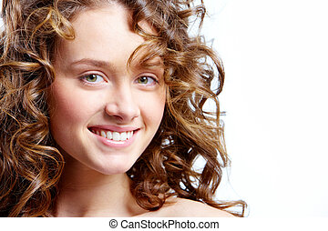 Natural beauty - Image of beautiful young woman with curly...