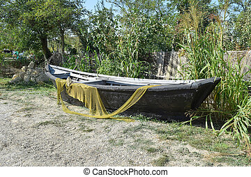 Fishing boats and nets The boat with nets are dried and...