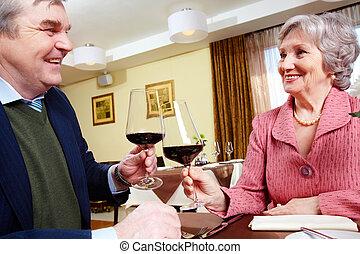 Anniversary - Image of smiling senior couple celebrating...
