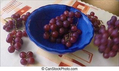 Bowl with fresh dark grapes