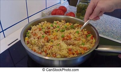 Vegetable risotto on a frying pan