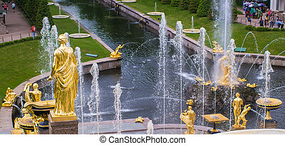 Gold-plated statue and fountains.