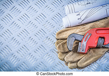 Monkey wrench blueprints safety gloves on grooved metal backgrou