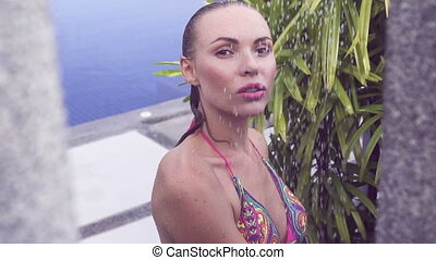 Sexy woman in bikini taking shower - Face close up of sexy...