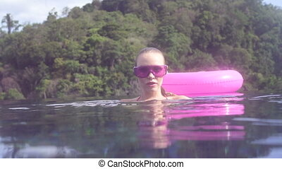 Waterside and underwater view woman - Waterside and...