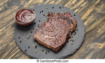 Steak and sauce rotate - Steak and sauce with pepper rotate