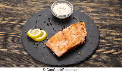 Fish steak on a wooden table rotate