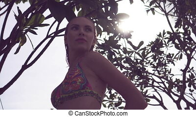 Bikini woman on rooftop with trees. - Sexy young woman...