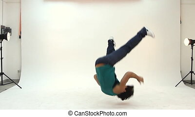 Teenager dancing breakdance in action - Teenager male...