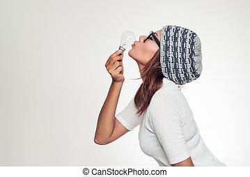 Asian woman kissing lamp
