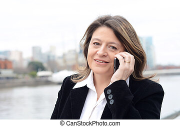 Close up of business woman talking on her smartphone.