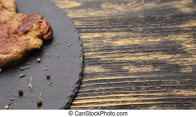 Steak on a wooden table.