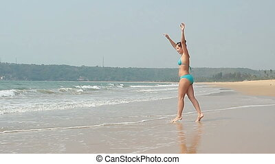 Beauty woman relaxing on the Goa beach at sunny day