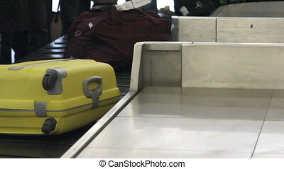 Luggage travels on a conveyor belt at the airport - Luggage...