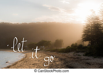 Let It Go message. Handwritten motivational text over sunset...