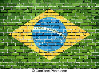 Flag of Brazil on a brick wall