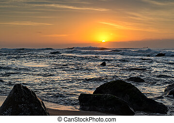 Umhlanga Rocks Beach at Sunrise - View of ships on the...