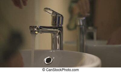 Closeup of woman washing hands.