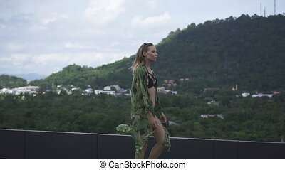 Glamour woman on a rooftop in a sun