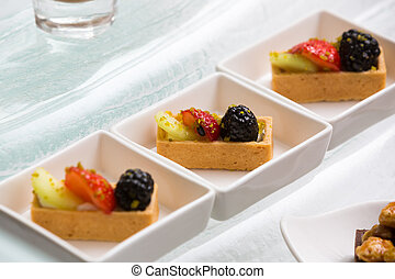 close up of square fruit tart in modern plate