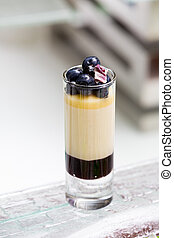 blueberry parfait in tall glass on the table