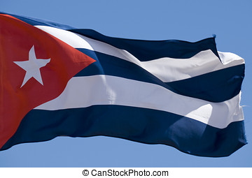 Cuban Flag - The Cuban flag flying against a bright blue...