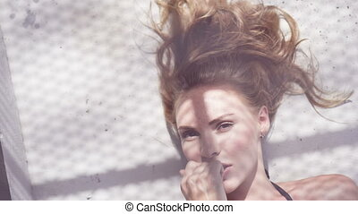 Glamour woman on a rooftop in a sun - Closeup portrait of...