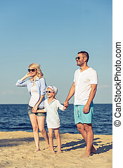 Family on the beach - Beautiful young parents and their cute...