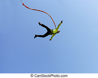 rope jumping - Jump off a cliff into a canyon with a rope