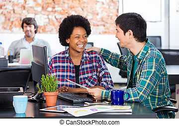 Two colleagues african american woman asian man diverse mix...
