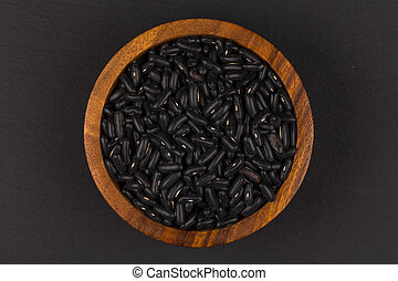 Black eyed peas beans in wooden bowl on a dark background