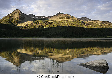 East Beckwith Mountain is reflected in Lost Lake Slough in...
