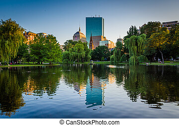 The lake at the Boston Public Garden and buildings at Copley...