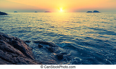 Sunset on rocky sea shores islands - Sunset on rocky sea...
