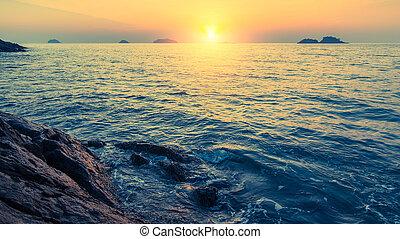 Sunset on rocky sea shores islands - Sunset on rocky sea...