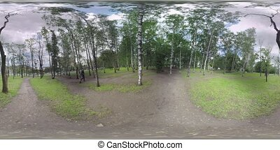 360 VR Park with birches near the busy motorway in Moscow,...