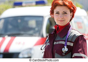 Positive female paramedic on ambulance vehicle background