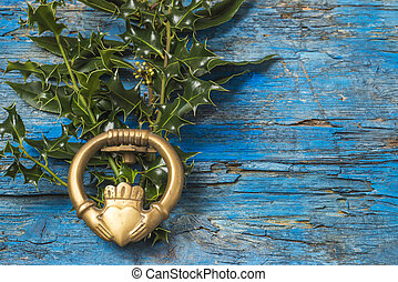 Claddagh and holly branches irish symbol of love, friendship...