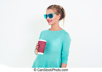 Woman wearing mint blue sunglasses and top with messy...