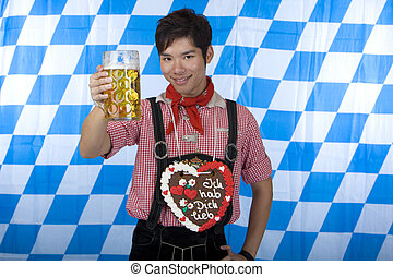 Young happy Asian man holds Oktoberfest beer stein - Young...