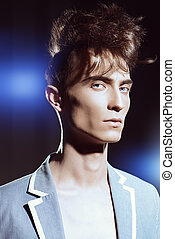 fashion show - Fashion male model with stylish upright hair....