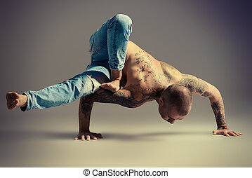 handstand - A man doing yoga exercises. Studio shot over...