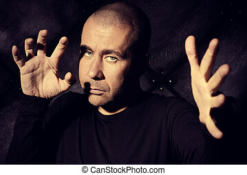 extrasensory - Yoga concept. Mature man in black clothes...