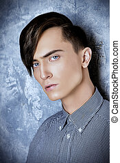 male hairstyle - Portrait of a young man with fashionable...