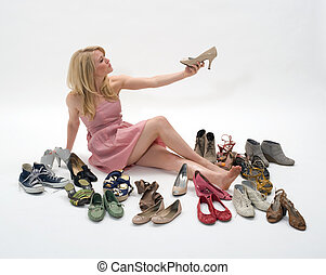 shoe store - happy young blond woman sitting on the floor...