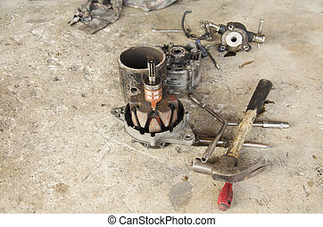 Repair and inspecting the alternator in car at local shop -...