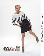 avocation - young blond posing alongside 3 pairs of shoes