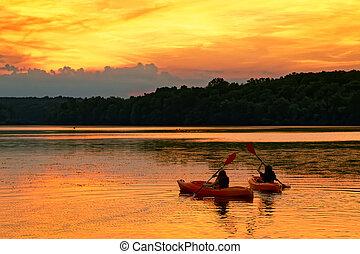 Kayaks on a Lake at Sunset.