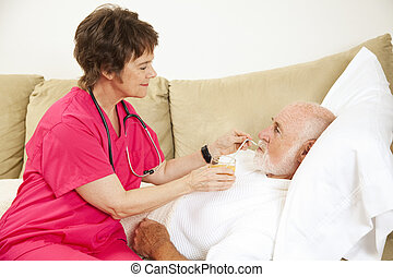 Home Health - Fluid Intake - Home nurse helps elderly...